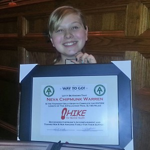 Neva with her plaque from HIKE for Mental Health