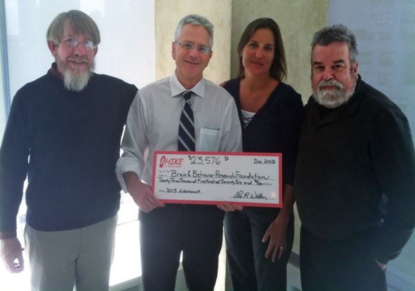 Leo, Nancy, and Tom present the 2013 check to Dr. Jeffrey Borenstein of the Brain & Behavior Research Foundation