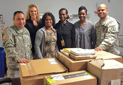 Staff at the VA Medical Center receive supplies from HIKE for Mental Health