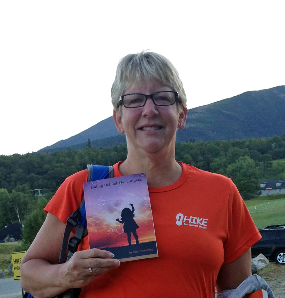Sue Twombley with her book