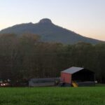 View of Pilot Mountain over farm house